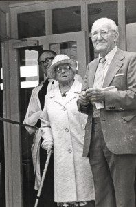 Alice Cross standing with Tom Hocking outside the centre